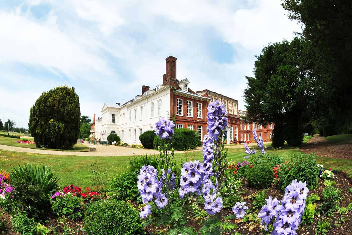 South East aspect of Gosfield Hall with beautiful flowers