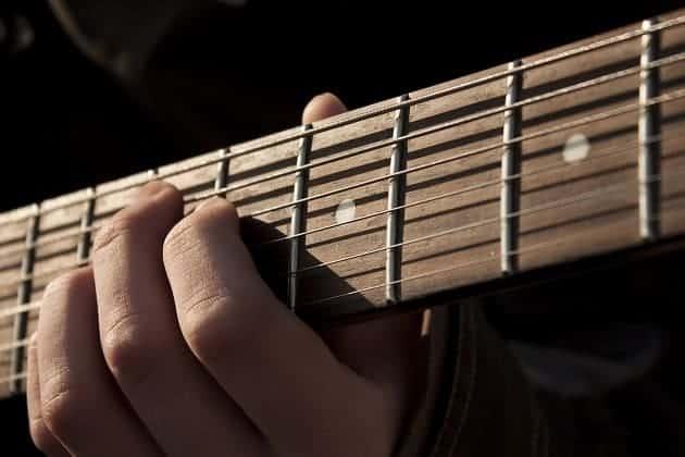 Guitar fret board